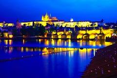 Prague castle and Charles bridge at dusk stock photography