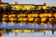 Prague castle and the Charles bridge at dusk. Reflection of Prague castle and the Charles bridge at dusk Royalty Free Stock Images