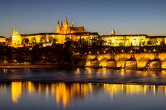 Prague castle and the Charles bridge at dusk. Reflection of Prague castle and the Charles bridge at dusk Stock Image