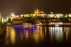 Prague castle and the Charles bridge at dusk. Reflection of Prague castle and the Charles bridge at dusk Royalty Free Stock Photos