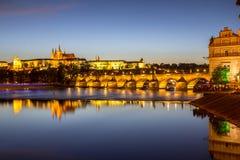 Prague castle and the Charles bridge at dusk. Reflection of Prague castle and the Charles bridge at dusk Royalty Free Stock Image