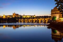 Prague castle and the Charles bridge at dusk. Reflection of Prague castle and the Charles bridge at dusk Stock Photos