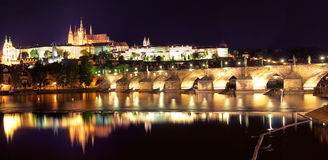 Prague castle and Charles Bridge at the night Stock Photos