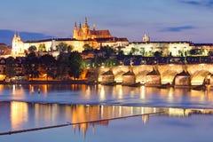 Prague castle and Charles bridge at night Stock Image