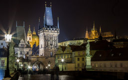 Prague castle from the Charles bridge at night Stock Photography