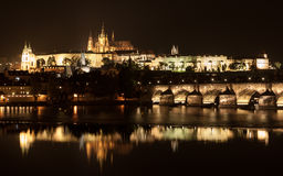 Prague Castle and Charles Bridge at night Stock Photos