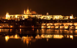 Prague Castle and Charles Bridge at night Stock Image