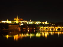Prague Castle and Charles Bridge. Night view of Prague Castle and the Charles Bridge from the Vltava river bank (Czech Republic stock photography