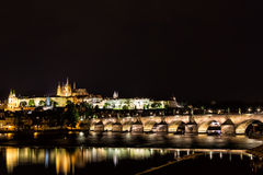 The Prague Castle and the Charles Bridge over Vltava river with nice water reflections at night in Prague, Czech Republic.  Royalty Free Stock Photography