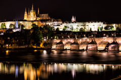 The Prague Castle and the Charles Bridge over Vltava river at night in Prague, Czech Republic Royalty Free Stock Image