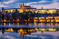 Prague Castle. And Charles Bridge at sunset with reflection on Vltava river Royalty Free Stock Photos