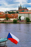 Prague castle with czech flag stock photography