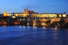 Prague castle, Czech Republic. Shining Prague castle and Charles bridge in the early evening, Czech Republic, Europe Royalty Free Stock Photos