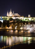 Prague Castle, Czech Republic. A night view over the Vltava river in Prague looking towards the Charles Bridge and Prague Castle on the hilltop stock photo