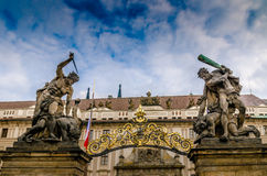 Prague Castle gate statues. Fighting giants statues at the Castle gate in Prague's Castle Quarter Royalty Free Stock Photos