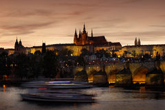 The Prague Castle, gothic style, largest ancient castle in the world, and Charles Bridge are the symbols of Czech capital, built i Stock Images