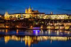 Prague Castle, Hradcany reflecting in Vltava river in Prague, Czech Republic at night Stock Images