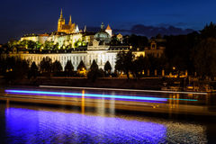 Prague castle in Hradcany with Vlatava river and lights from boats Stock Photos