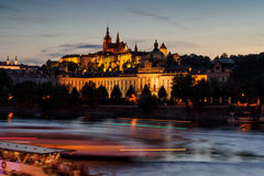 Prague castle in Hradcany with Vlatava river and lights from boats Royalty Free Stock Photos