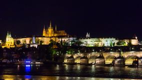 Prague castle with light up and Vltava river Stock Images