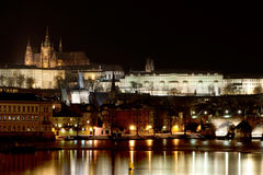 Prague castle at night. With reflection on river Stock Photos