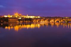 Prague Castle at night. Prague Castle and Charles Bridge over Vlatva River at night royalty free stock photo