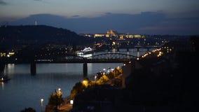 Prague castle night skyline panorama view bridge train railway traffic. Boats stock footage