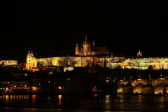 Prague Castle at Night. View of Prague Castle at night, the largest ancient castle in the world, with the river and Charles Bridge in front of it (Prague, Czech Stock Photography