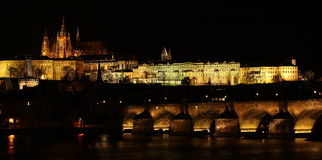 Prague Castle at Night. View of Prague Castle at night, the largest ancient castle in the world, with the river and Charles Bridge in front of it (Prague, Czech Royalty Free Stock Photos