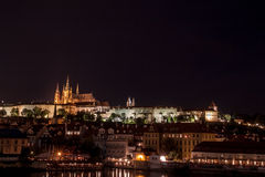 Prague Castle panorama. View of the Prague Castle at night from Charles bridge stock photo
