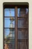 Prague castle reflection. Prague castle Saint Vitus cathedral tower reflected in a window stock photos