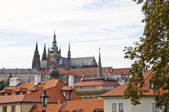 Prague castle and rooftops of old town Stock Images