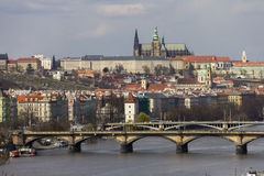 Prague castle and the saint Vitus Cathedral with Vltava river and old bridges crossing it under them Stock Photography
