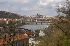 Prague castle and the saint Vitus Cathedral with Vltava river and old bridges crossing it under them Stock Photo