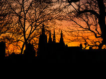 Prague Castle silhouette at sunstet time hidden behind trees Stock Photography