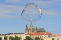 Prague, the Castle and St. Vitus Cathedral. Czech RepublicFlying soap bubble Royalty Free Stock Image