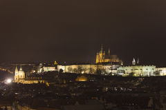 Prague Castle and St. Vitus Cathedral and Prague panorama at night in winter Royalty Free Stock Photo