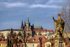 Prague castle and stone statue on Charles bridge, Czech republic Stock Images