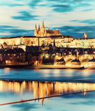 Prague Castle with surrounding buildings across the river Royalty Free Stock Image