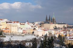 Prague castle in winter, Prague, Czech republic. Prague castle and snowy roofs of Mala Strana from Seminarska Garden in Prague, Czech republic Royalty Free Stock Photos