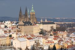 Prague castle in winter, Prague, Czech republic. Prague castle and snowy roofs of Mala Strana from Seminarska Garden in Prague, Czech republic Royalty Free Stock Image