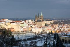 Prague castle in winter, Prague, Czech republic. Prague castle and snowy roofs of Mala Strana from Seminarska Garden in Prague, Czech republic Stock Images