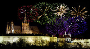 Prague castleand New Year celebrations. Prague castle in the night - residence of czech president and colorful fireworks during the New Year celebrations stock image