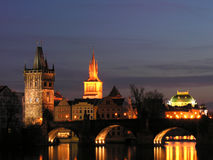 Prague Charles Bridge. Charles Bridge at night with Old Town Tower and National Theatre Stock Photos