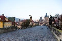 Prague Charles Bridge. The beautiful cobblestoned Prague Charles Bridge early in the morning Stock Photography