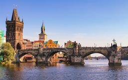 Prague Charles bridge, Czech Republic. Scenic landscape of Prague city with historical architecture of old town. Over Vltava river on clear summer day Stock Photo
