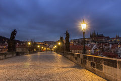 Prague Charles bridge at dawn. Charles Bridge and Prague Castle in Prague (Czech Republic) at night lighting Royalty Free Stock Images