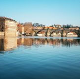 Prague, Charles bridge reflected in Vltava river in the morning Stock Photos