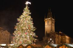 Prague Christmas Market, Christmas Tree and Prague astronomical tower Orloj royalty free stock photo
