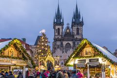 Prague Christmas market on the night in Old Town Square with blu. Rred people on the move. Prague, Czech Republic stock photography
